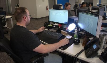 image of customer service team leader at desk - Freightcom staff
